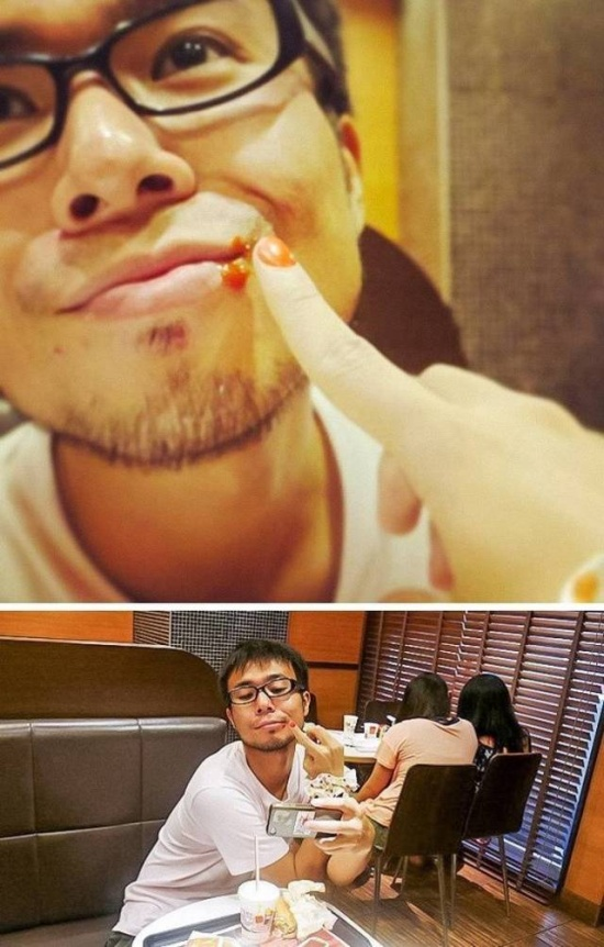 11 - Guy with a girl wiping face. Guy taking selfie in fast food restaurant.