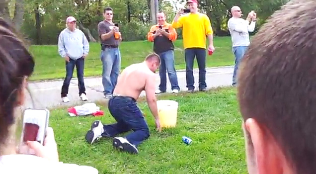 Guy Dunks Head In Piss Bucket view on ebaumsworld.com tube online.
