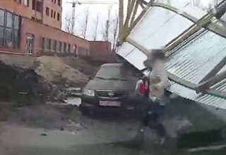 Flying Fence Knocks Down Two People In Russia