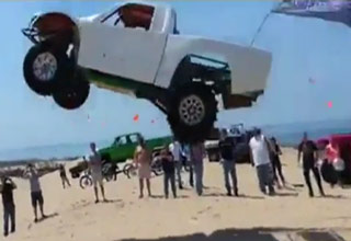 Truck Gets Massive Air Jumping Sand Dune