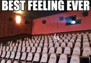 Guy sitting alone in a movie theater. text: Best Feeling Ever