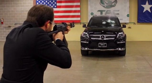 guy shooting ak47 at mercedes