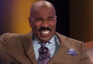 steve harvey laughing