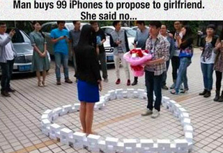 guy using iphones to propose to girlfriend