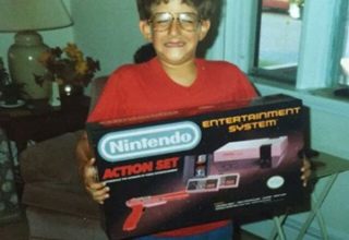 kid holding the nintendo action set ente