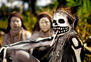 man with tribal skeleton makeup
