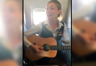 Flight Attendant playing the guitar