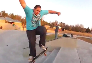 fat guy doing ollie up stai