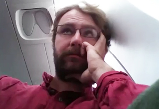 guy annoyed on plane