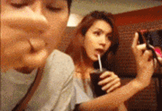 girl taking selfies while eating
