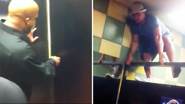 guy climbing toilet stall wall