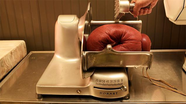boxing glove in meat slicer