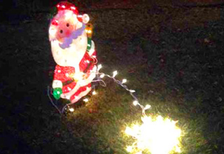 santa claus light peeing on lawn