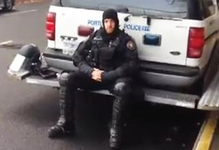 riot cop sitting down