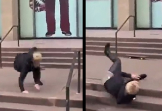 Justin Bieber falling down steps on a skateboard.