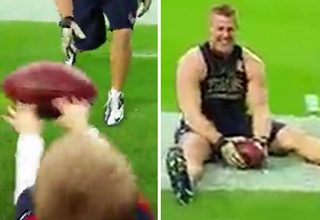 J.J. Watt sitting on field laughing
