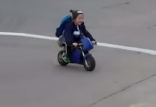 kindergartner rides motorcycle to school