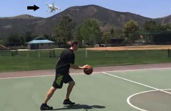 quad-copter filming basketball player