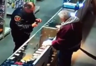cop shoots himself in gun store