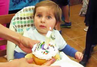 1 year old boy and birthday cupcake