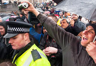 guy pouring beer on cops' head
