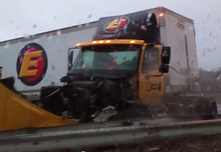 tractor trailer out of control barely misses car