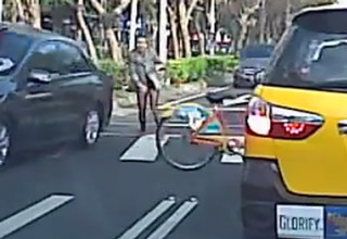woman on bike hit by car bike goes flying