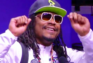 marshawn lynch wearing shades and hat