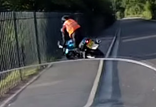 motorcycle rider crashes into fence