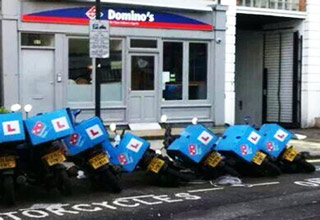 motorcycles fall over like dominos in front of a dominos