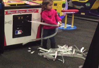 girl pulls tickets out of machine
