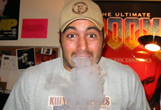 joe rogan exhaling a huge cloud of smoke