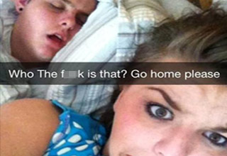 girl takes selfie doesn't know who is in bed next to h