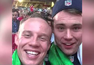 2 guys smiling at the super bowl