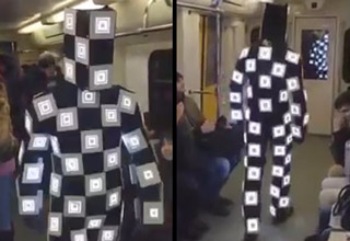 guy with LED flashing suit on subway