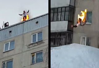 guy sets himself on fire jumps from b