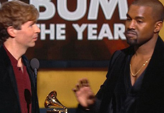Beck onstage holding a Grammy, and Kanye reaching for his microphone.