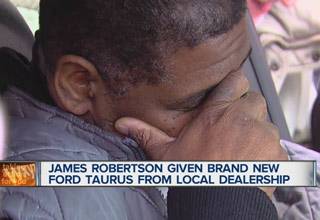 man cries tears of joy over free new car
