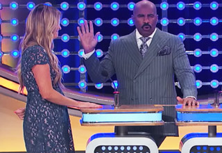 blonde woman and steve harvey on family feud