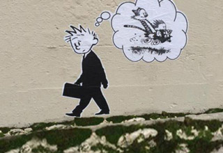 Calvin from Calvin and Hobbes as an adult in a suit remembering when he was young and used to have fun.