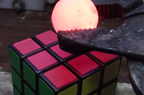 red hot nickel ball on rubiks cube