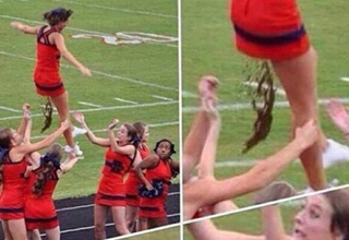 cheerleader at the top of a pyramid pooping. the cheerleaders underneath look