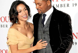 Will Smith looks at Rosario Dawson's breasts on the red carpet.