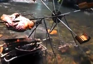 water powered rotisserie by the river