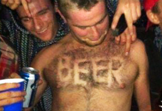 guy has the word beer shaved into his chest