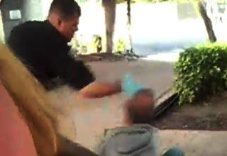 police officer slaps homeless man