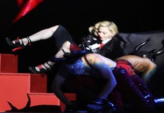 madonna falls down stairs