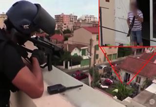 cop shoots man with gun