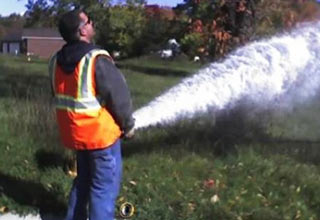 guy spraying hose like he's peeing