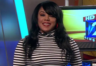 news anchor in striped dress channel